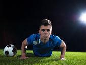 Bola e jogador de futebol — Fotografia Stock