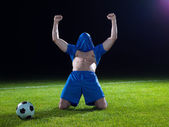 Soccer player with jersey on his head — Foto de Stock