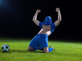 Soccer player with jersey on his head — Stock Photo