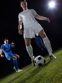 Soccer players duel — Stock Photo
