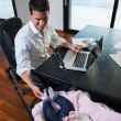 Man working from home and take care of baby — Stock Photo #49668105