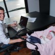 Man working from home and take care of baby — Stock Photo #49668139