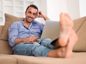 Relaxed young man at home — Foto Stock