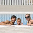 Happy young family have fun on swimming pool — Stock Photo #4979982