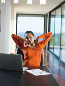 Woman working on laptop computer at home — Stock Photo