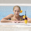 Beautiful woman relax on swimming pool — Stock Photo #4992181
