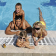 Happy young family have fun on swimming pool — Stock Photo #4994540