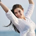 Young woman enjoy on beach — Stock Photo #5742871