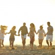 Happy young group have fun on beach — Stock Photo #5850485