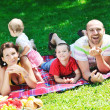 Happy young couple with their children have fun at park — Stock Photo #6721009