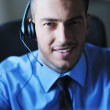 Businessman with a headset — Stock Photo #7219964