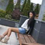 Beautiful young lady posing in garden — Stock Photo #7274677