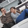 Relaxed young couple watching tv at home — Stock Photo #7402245