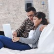 Relaxed young couple watching tv at home — Stock Photo #7403446