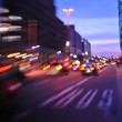 City night with cars motion blurred light in busy street — Stock Photo #7574543