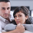 Relaxed young couple watching tv at home — Stock Photo #7592145