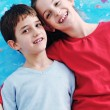 Portrait of happy brother and sister at home — Stock Photo #8491737