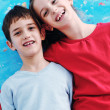 Portrait of happy brother and sister at home — Stock Photo #8491814