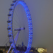 Spinning London Eye and view of the South bank at night — Stock Photo
