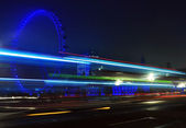 Spinning London Eye close detail at night with blue lights — Stock Photo