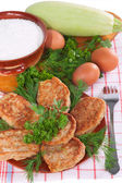 Pancakes from zucchini with aromatic herbs. — Stock Photo