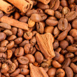 Stock Photo: Background of placers of coffee beans and cinnamon sticks cl