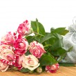 Bouquet of roses and gift to substrate. — Stock Photo #39496921