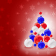 Christmas decorations on red snowflake background — Stock Photo