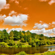 Panorama with river under orange sky — Stock Photo #24181221