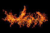 Bright flame stripe isolated on black — Stock Photo