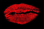 Red lips isolated on black — Stock Photo
