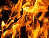 Dark yellow flame background — Stock Photo
