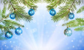 Fir half frame and snowflakes on blue — Stock Photo