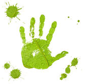 Hand imprint and blots on green leaf background — Stock Photo