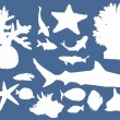 Sea animals silhouettes collection on blue — Stock Vector #24186965