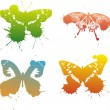 Four color butterflies with blots — Stock Vector