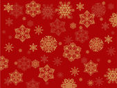 Yellow snowflakes on red background — Stock Vector