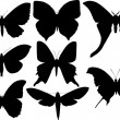 Stock Vector: Set of eight butterfly wings shapes