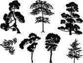 Set of seven black trees on white — Stock Vector