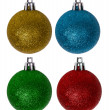 Four colors new-year tree decorations on white — ストック写真