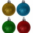 Four colors new-year tree decorations on white — Stock Photo
