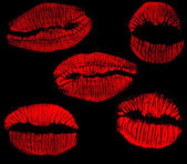 Set of red lips imprints on black — Stock Photo