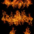 Set of large orange flames isolated on black — Stock Photo #34888911