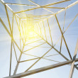 Inside of steel pylon and bright sun — Stockfoto