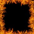 Large orange flame isolated on black — Stock Photo