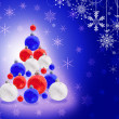 Christmas decorations on blue snowflake background — Stock Photo