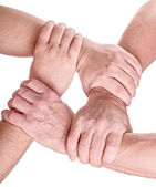 Four man hands holding each other — Stock Photo