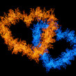 Orange and blue heart shape flame isolated on black — Stock Photo