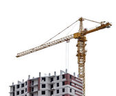 Crane near red and white unfinished brick house — Stock Photo