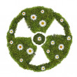 Nuclear symbol from green moss and flowers — Stock Photo